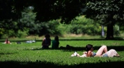 People bask in the sun and cool down in the shade on a hot summer day at Trinity Bellwoods Park in Toronto in this file photo from Tuesday, July 16, 2013. (The Canadian Press/Michelle Siu)