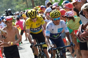 Colombia's Nairo Quintana, wearing the best young rider's white jersey, and Britain's Chris Froome, wearing the overall leader's yellow jersey, climb in the final kilometers of the fourteenth stage of the Tour de France cycling race over 178.5 kilometers with start in Rodez and finish in Mende, France, Saturday, July 18, 2015. (AP/Jeff Pachoud, Pool)