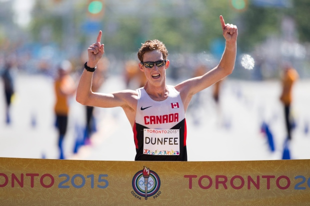 Canada's Evan Dunfee crosses the finish to win the men's 20km race walk at the Pan Am Games in Toronto, Ontario, Sunday, July 19, 2015. (AP / Felipe Dana)