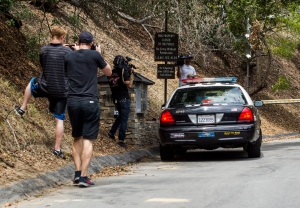 A police car arrives an entrance to the home of actress Demi Moore, in Beverly Hills, Sunday, July 19, 2015. (Ringo H.W. Chiu / AP Photo)