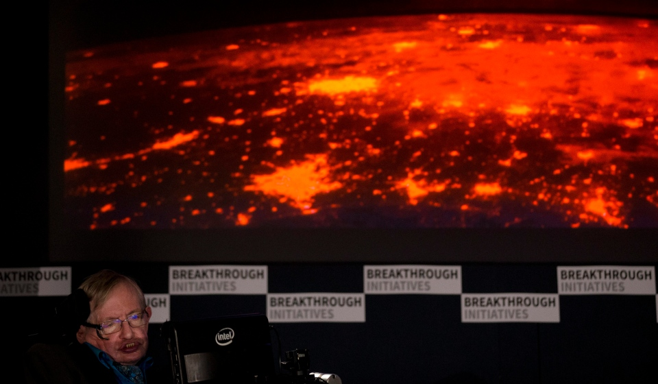Renowned physicist Stephen Hawking sits in front of a presentation image during a press conference in London, Monday, July 20, 2015. (AP Photo/Matt Dunham)