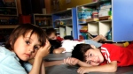 Children take a nap at a day care centre in Montreal on Friday, August 18, 2006. (CP PHOTO/Ian Barrett)