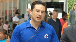 Minister of Employment and Social Development Pierre Poilievre wears a Conservative Party golf shirt during an announcement on child care benefit payments, in Halifax, Monday, July 20, 2015.