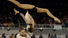 Canada's team performs during rhythmic gymnastics group clubs and hoops competition in the Pan Am Games in Toronto Monday, July 20, 2015. Canada won the bronze medal in the event. (AP Photo/Gregory Bull)