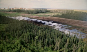 A Nexen-supplied image of a pipeline oil spill near the Long Lake oil sands operation is shown at a press conference in Calgary, Alta., on July 17, 2015.(Larry MacDougal / The Canadian Press)