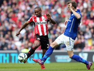 Sunderland's Jermain Defoe, left, vies for the ball with Leicester City's Andy King, right, during their English Premier League soccer match between Sunderland and Leicester City at the Stadium of Light, Sunderland, England on May 16, 2015. (Scott Heppell / The Canadian Press)