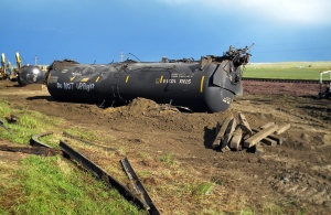 This July 17, 2015 file photo shows derailed oil tanker cars lie off track near Culbertson, Mont.  (AP / Richard Peterson)