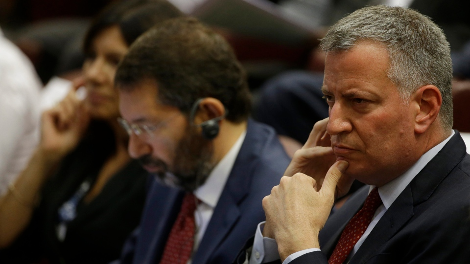 New York Mayor Bill de Blasio, right, flanked by Rome Mayor Ignazio Marino, center, and Paris Mayor Anne Hidalgo attend a conference on Modern Slavery and Climate Change in the Synod Hall at the Vatican, Tuesday, July 21, 2015. (AP / Gregorio Borgia)