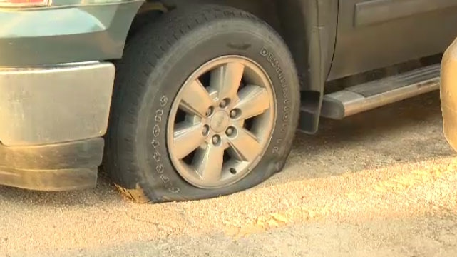 Neighbours awoke Monday morning to find their tires had been slashed and graffiti on several buildings (File Photo).