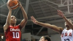 Canada's Nirra Fields goes up for a shot against United States' Stephanie Mavunga during the second quarter of the women's basketball gold medal game at the Pan Am Games, Monday, July 20, 2015, in Toronto. (AP Photo/Julio Cortez)