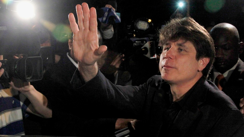 Former Illinois Gov. Rod Blagojevich waves as he departs his Chicago home, on March 15, 2012. (AP / Charles Rex Arbogast)