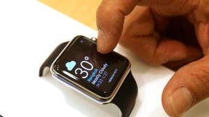 A customer checks out an Apple Watch in Thailand, on Friday, July 17, 2015.(Sakchai Lalit/AP Photo)
