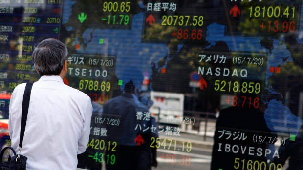 Toronto stock index slips, United States markets almost flat ahead of holiday weekend
