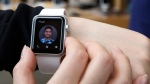 In this April 10, 2015, file photo, a customer tries on an Apple Watch at an Apple Store in Hong Kong. (AP / Kin Cheung, File)