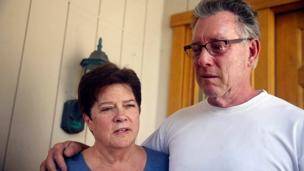Liz Sullivan, left, and Jim Steinle, right, parents of Kathryn Steinle, talk to members of the media outside their home in Pleasanton, Calif. on Thursday, July 2, 2015. (Lea Suzuki / San Francisco Chronicle)