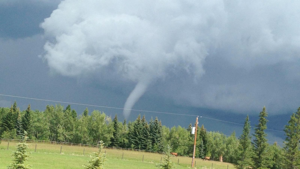 A funnel cloud over the skies north of Priddis, Alta., near Calgary, Wednesday, July 22, 2015. (Michael Kent)