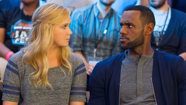 separation shoes 7dae5 1f221 This image released by Universal Pictures shows Amy Schumer, left, and LeBron  James, in a scene from the comedy,