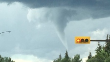 A funnel cloud forms in the skies over Calgary