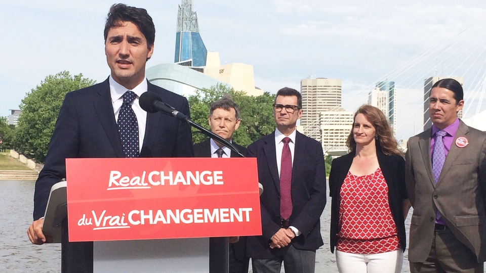 Liberal Leader Justin Trudeau, alongside Manitoba Liberal candidates, talks to reporters in Winnipeg, Thursday, July 23, 2015. (Steve Lambert / THE CANADIAN PRESS)