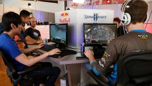 "In this photo taken Friday, June 21, 2013, Kyeong Hyun ""SeleCT"" , left, joins seven of the world's best ""StarCraft II"" video game players to train at Red Bull Training Grounds, held at Red Bull North America headquarters in Santa Monica, Calif. (Damian Dovarganes / AP Photo)"
