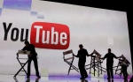 Stage crew workers prepare the set for a keynote speech by YouTube at the 2012 International Consumer Electronics Show in Las Vegas, Thursday, Jan. 12, 2012. (AP / Julie Jacobson)