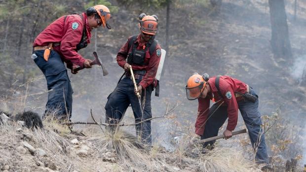 Firefighters working in West Kelowna, B.C.