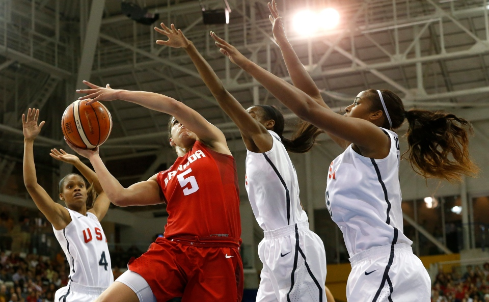 Canada's Kia Nurse, second from left, goes up for a shot against United States' Moriah Jefferson, from left, Shatori Walker and Alaina Coates during the first quarter of the women's basketball gold medal game at the Pan Am Games, Monday, July 20, 2015, in Toronto. (AP /Julio Cortez)