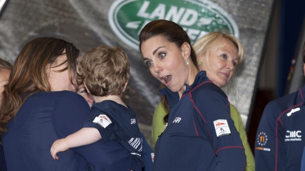 Kate, the Duchess of Cambridge, second left, meets family members on a visit to the new BAR, Ben Ainslie Racing team base for the America's Cup World Series, in Portsmouth, England, Sunday July 26, 2015. (Ian Vogler / AP)