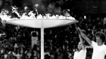 Left to right, Sandra Henderson, 16, of Toronto, and Stephane Prefontaine, 14, of Montreal share the honor of igniting the urn at Olympic stadium during the opening of the 1976 Olympic Games in Montreal--Canada's first and only time hosting the Summer Olympics. (CP PHOTO/ files)