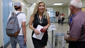 Liberal MP Eve Adams is seen as party members in the Toronto riding of Eglinton-Lawrence vote for their election candidate on Sunday, July 26, 2015.  (THE CANADIAN PRESS/Colin Perkel)