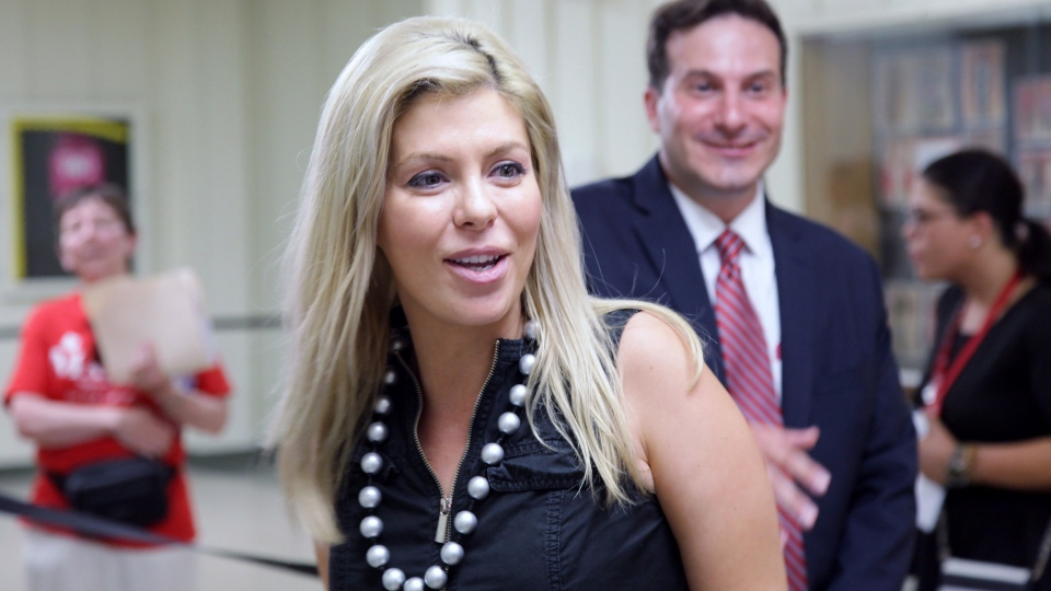 Former Conservative MP Eve Adams, left, is seen with rival Marco Mendicino as Liberals chose a candidate to represent them in the Toronto riding of Eglinton-Lawrence on Sunday, July 26, 2015. Adams' welcome into the party by Liberal Leader Justin Trudeau angered some party members. (Colin Perkel /The Canadian Press)