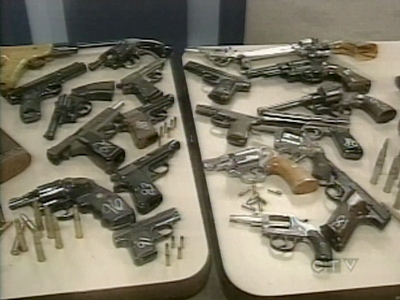At a Tuesday, Nov. 11, 2008 news conference, police at 54 Division displayed 20 handguns surrendered by an area resident.