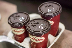 Cups of coffee sit on a counter in a Tim Hortons outlet in Oakville, Ont. on Monday September 16, 2013. (Chris Young / THE CANADIAN PRESS)