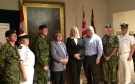 MPs Ed Holder and Susan Truppe, centre, pose for a photo at the Wolseley Barracks in London, Ont. on Monday, July 27, 2015. (Office of MP Susan Truppe)