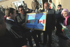 Foreign Affairs Minister Peter MacKay, left, looks at the gift he received from Afghan authorities at the Canadian-funded Vocational Training Center for Vulnerable Afghan People in Kabul. (AP Photo, Musadeq Sadeq)