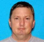 This undated Oregon driver identification photo released Monday, July 27, 2015, by the Charleston, W. Va., Police Department shows Neal Falls, of Springfield, Ore., killed by a woman he attacked on July 18 in Charleston. (Oregon DMV / Charleston Police Department via AP)