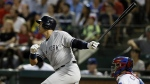 New York Yankees' Alex Rodriguez follows through on a solo home run swing off a pitch from Texas Rangers' Matt Harrison as Rangers catcher Robinson Chirinos watches in the sixth inning of a baseball game in Arlington, Texas on July 27, 2015. (AP / Tony Gutierrez)