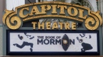 """The Capitol Theatre marquee displays the """"Book of Mormon"""" musical in Salt Lake City on July 27, 2015. (AP / Rick Bowmer)"""