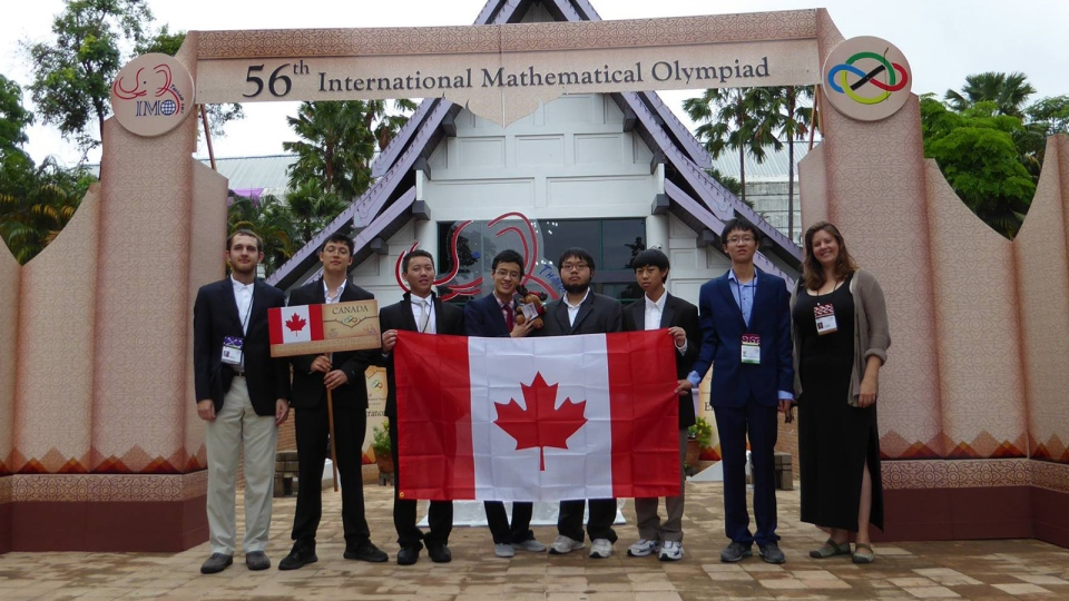 Alex Song, fifth from the left, poses with Team Canada at the 56th International Mathematical Olympiad.