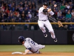 Troy Tulowitzki jumps over San Diego Padres' Jedd Gyorko during the fourth inning of a baseball game in Denver on April 21, 2015. (AP / Jack Dempsey)