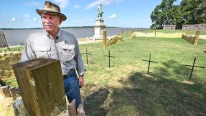 "William ""Bill"" Kelso, Director of Research and Interpretation for the Preservation Virginia Jamestown Rediscovery, stands next to the church where the four sets of human where found in Jamestown, Va. on July 28, 2015. (Joe Fudge / The Daily Press)"