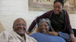 In this photo supplied by Oryx Media retired Anglican Archbishop Desmond Tutu, left, with his wife Leah, centre, and daughter Mpho Tutu at the Tutu home in Cape Town South Africa Tuesday, July 21, 2015. (Benny Gool / Oryx Media via AP)