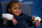 Double-hand transplant recipient eight-year-old Zion Harvey smiles during a news conference Tuesday, July 28, 2015, at The Children's Hospital of Philadelphia (CHOP) in Philadelphia. (Matt Rourke / AP Photo)