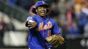 New York Mets relief pitcher Jenrry Mejia tosses the ball to throw out Colorado Rockies' Josh Rutledge at first base to end a baseball game, in New York on Sept. 10, 2014. (AP / Frank Franklin II)
