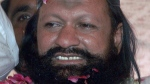 Malik Ishaq, a leader of the banned Sunni Muslim group Lashkar-e-Jhangvi, is greeted by supporters upon his arrival at his hometown in Rahim Yar Khan, Pakistan on July 15, 2011. Ishaq was killed in a shootout with police on July 29, 2015. (AP / Khalid Tanveer)