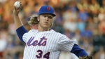 New York Mets starting pitcher Noah Syndergaard (34) delivers in the first inning of a baseball game against the San Diego Padres in New York on July 28, 2015. (AP / Kathy Willens)