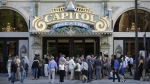 "People enter the Capitol Theatre to see ""The Book of Mormon"" musical in Salt Lake City on July 28, 2015. (AP / Rick Bowmer)"