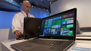 In this April 29, 2015 file photo, a Dell laptop computer running Windows 10 is on display at the Microsoft Build conference in San Francisco. (Jeff Chiu/AP Photo)