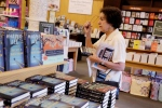 Emma Davila picks up a copy of Harper Lee's 'Go Set a Watchman' as she walks to the sales register, Tuesday, July 14, 2015 at a Barnes & Noble bookstore in New York. (AP /Mark Lennihan)