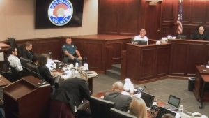 In this image made from Colorado Judicial Department video, Robert Holmes, top second from right, the father of James Holmes, gives testimony during the sentencing phase of the Colorado theater shooting trial in Centennial, Colo., on Wednesday, July 29, 2015. (Colorado Judicial Department via AP)